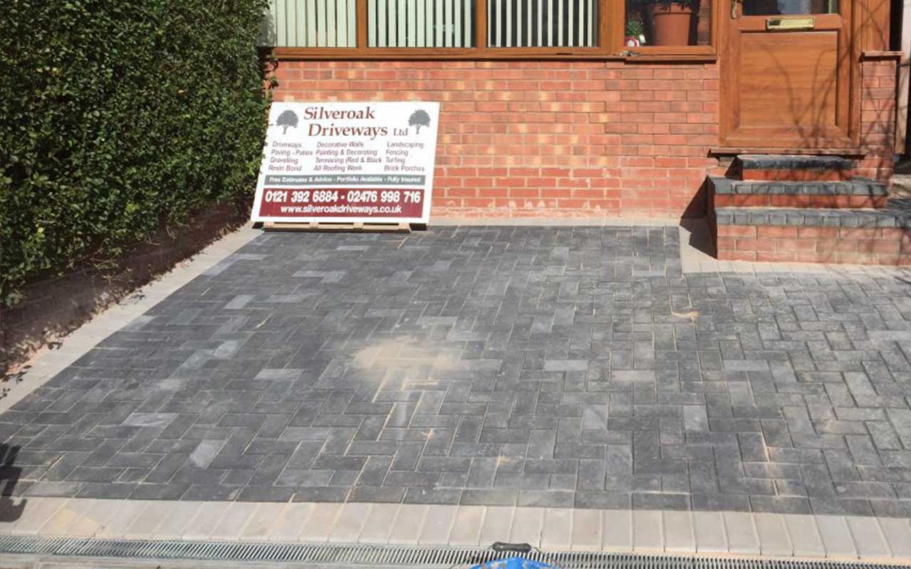block paving and company advertisement sign