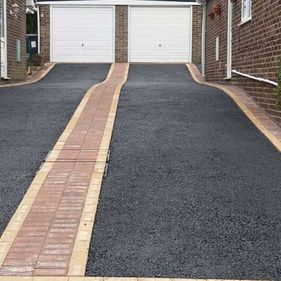 Tarmac Driveway and white garages